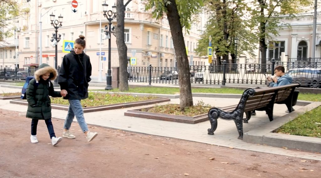 Governess and child walking in Moscow